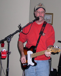 "Jack Burt from the ""Hats Off Band"" Plays guitar and sings"